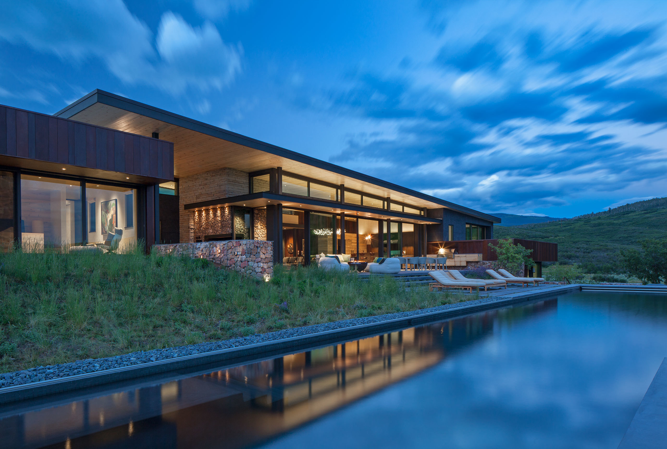 CCY Architects Gambel Oaks Ranch - USGBC LEED Gold. Pool terrace at dusk. Image by Art Gray.
